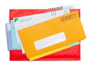 Small Stack of Envelopes Isolated on White Background.